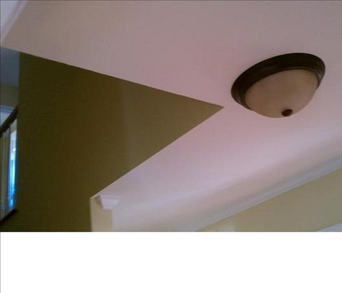 ceiling with white drywall and tan walls