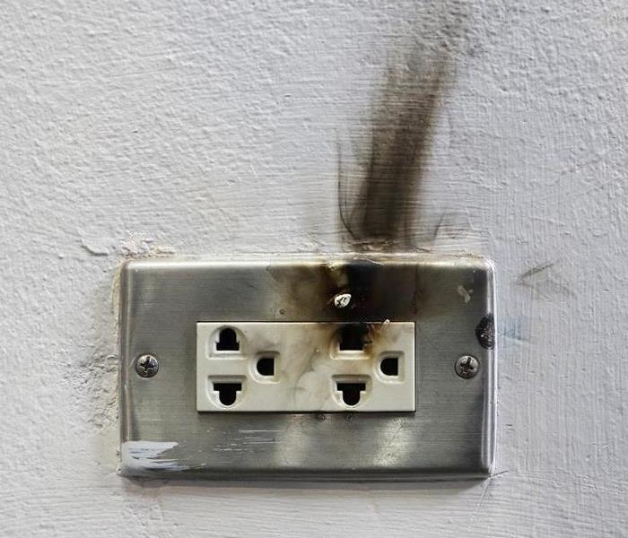 outlet in wall with smoke damage line