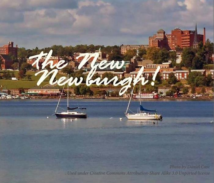 "Sail boats on the water in front of a town with a caption of ""The New Newburgh!"""