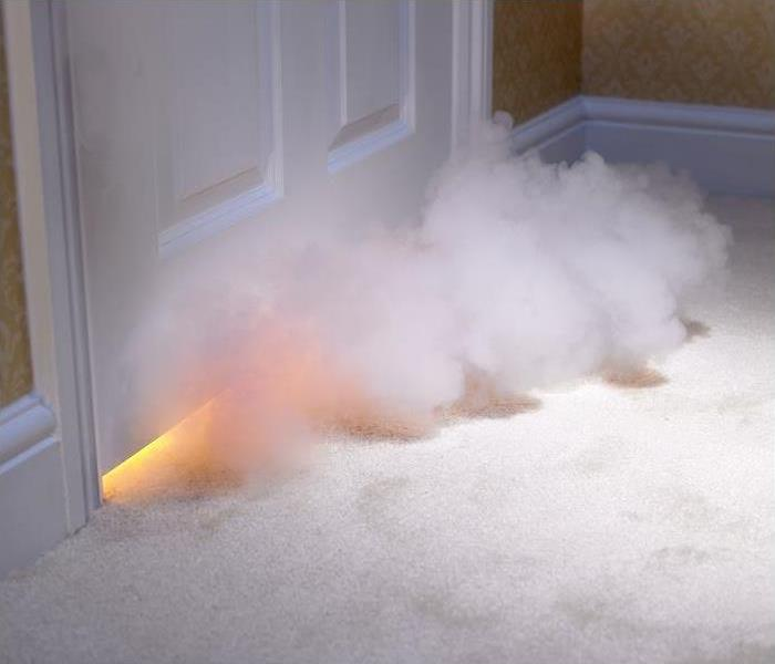 Smoke coming under door; flames seen under door